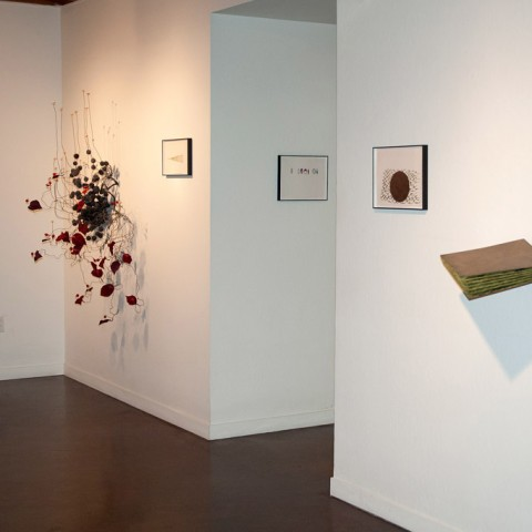 Background: Robert Ortbal - <b>Architecture of a Scent: Cinnamon</b>,  2012, wire, dissected fake flower parts, seed pods, cork, foil, tool dip, heat shrink, paint and flock, 59 x 44 x 29; Foreground: <b> Layers-more like chapters</b>, 2013, masonite, paint and flock, 22 x 22.5 x 10